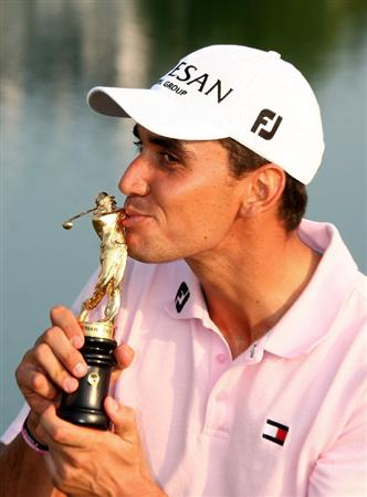 VIENNA, AUSTRIA - SEPTEMBER 20:  Rafael Cabrera-Bello of Spain celebrates with the trophy after shooting a final round 60 and seal a 1 shot victory during the fourth round of the Austrian Golf Open at Fontana Golf Club on September 20, 2009 in Vienna, Austria.  (Photo by Richard Heathcote/Getty Images)