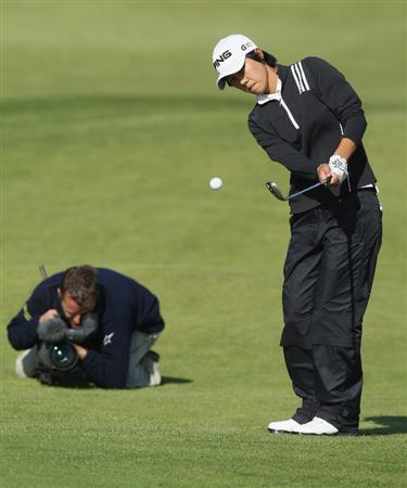 LYTHAM ST ANNES, ENGLAND - JULY 30:  Song-Hee Kim of Korea hits her fourth shot on the 15th hole filmed by a TV Cameraman during the first round of the 2009 Ricoh Women's British Open Championship held at Royal Lytham St Annes Golf Club, on July 30, 2009 in  Lytham St Annes, England.  (Photo by David Cannon/Getty Images)