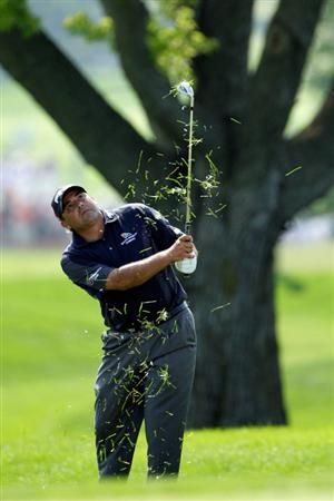 CHASKA, MN - AUGUST 14:  Angel Cabrera of Argentina plays a shot from the rough on the 18th hole during the second round of the 91st PGA Championship at Hazeltine National Golf Club on August 14, 2009 in Chaska, Minnesota.  (Photo by Jamie Squire/Getty Images)