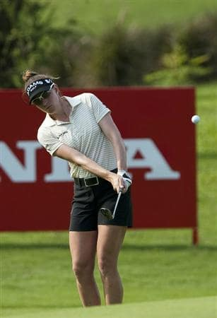 CHON BURI, THAILAND - FEBRUARY 17:  Brittany Lang of USA plays her second shot on the 16th hole during day one of the LPGA Thailand at Siam Country Club on February 17, 2011 in Chon Buri, Thailand.  (Photo by Victor Fraile/Getty Images)
