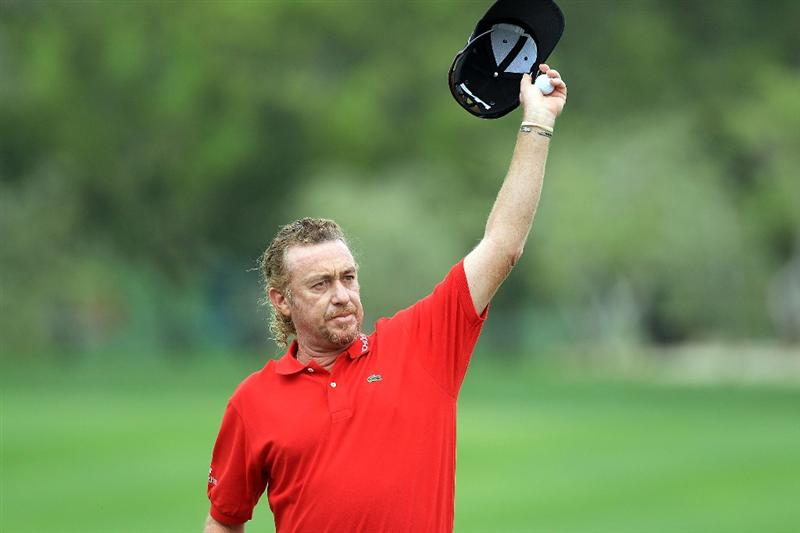 DUBAI, UNITED ARAB EMIRATES - FEBRUARY 06:  Miguel Angel Jimenez of Spain waves to the crowd at the 18th hole during the third round of the 2010 Omega Dubai Desert Classic on the Majilis Course at the Emirates Golf Club on February 6, 2010 in Dubai, United Arab Emirates.  (Photo by David Cannon/Getty Images)