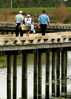 PORT SAINT LUCIE, FL - OCTOBER 25:  Frank Lickliter II and Lucas Glover make their way across a woo bridge after hitting their tee shot on the sixth hole during the Ginn Sur Mer Classic at Tesoro on October 25, 2007 in Port Saint Lucie, Florida.  (Photo by Doug Benc/Getty Images)