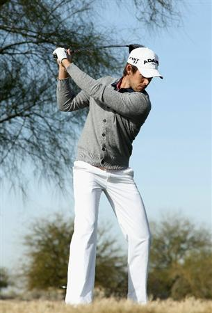 SCOTTSDALE, AZ - FEBRUARY 06:  Aaron Baddeley of Australia hits a tee shot on the 13th hole during the third round of the Waste Management Phoenix Open at TPC Scottsdale on February 6, 2011 in Scottsdale, Arizona.  (Photo by Christian Petersen/Getty Images)