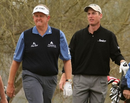 MARANA, AZ - FEBRUARY 20:  Colin Montgomerie of Scotland walks with Jim Furyk to the fourth fairway during the first-round matches of the WGC-Accenture Match Play Championship at The Gallery Golf Club at Dove Mountain on February 20, 2008 in Marana, Arizona.  (Photo by Scott Halleran/Getty Images)