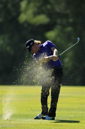 VIRGINIA WATER, ENGLAND - MAY 25:  Miguel Angel Jiminez of Spain hits an approach shot during the Pro-Am round prior to the BMW PGA Championship at Wentworth Club on May 25, 2011 in Virginia Water, England.  (Photo by David Cannon/Getty Images)