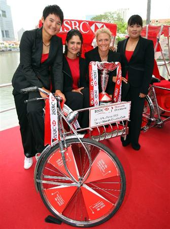 SINGAPORE - MARCH 03:  (L-R) Yani Tseng of Chinese Taipei; Lorena Ochoa of Mexico; Suzann Pettersen of Norway and Inbee Park of Korea pose with the trophy on a trishaw during a photocall and press conference in downtown Singapore prior to the start of the HSBC Women's Champions at Tanah Merah Country Club on March 3, 2009 in Singapore.  (Photo by Andrew Redington/Getty Images)