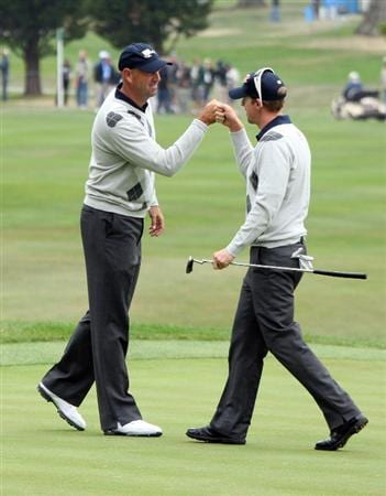 SAN FRANCISCO - OCTOBER 10:  Hunter Mahan of the USA Team celebrates with Stewart Cink celebrate a birdie at the 17th hole in their match against Singh and Allenby during the Day Three Morning Fousomes Matches in The Presidents Cup at Harding Park Golf Course on October 10, 2009 in San Francisco, California  (Photo by David Cannon/Getty Images)