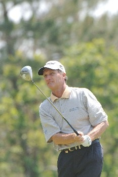 Gary Koch tees off on the seventh  hole during the opening round of the 2005 Blue Angels Class on May 13, 2005  in Milton, Fl. at The Moors Golf Club.Photo by Al Messerschmidt/WireImage.com