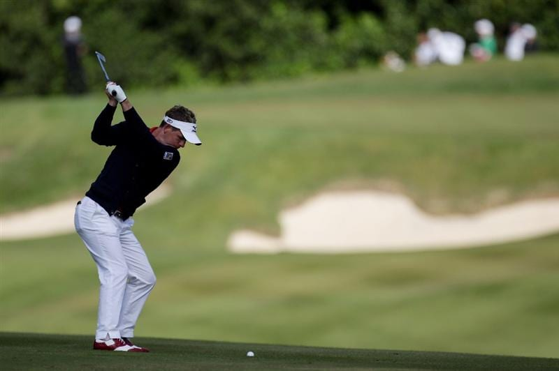 VIRGINIA WATER, ENGLAND - MAY 26:  Luke Donald of England hits his 2nd shot on the 1st hole during the first round of the BMW PGA Championship at Wentworth Club on May 26, 2011 in Virginia Water, England.  (Photo by Ross Kinnaird/Getty Images)