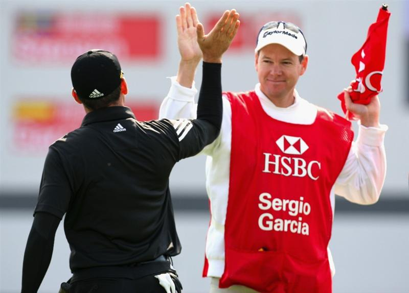 SHANGHAI, CHINA - NOVEMBER 10:  Sergio Garcia of Spain celebrates with his caddie Glen Moore after sinking the winning putt during the final round of the HSBC Champions at Sheshan Golf Club on November 10, 2008 in Shanghai, China.  (Photo by Ross Kinnaird/Getty Images)