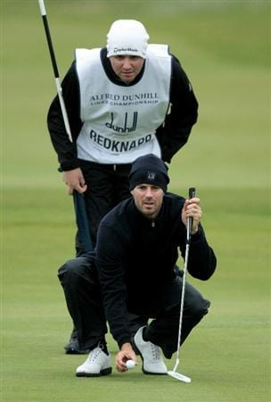 CARNOUSTIE, SCOTLAND - OCTOBER 09:  TV football pundit Jamie Redknapp with his caddie on the 18th green during the third round of The Alfred Dunhill Links Championship at the Carnoustie Golf Links on October 9, 2010 in Carnoustie, Scotland.  (Photo by David Cannon/Getty Images)