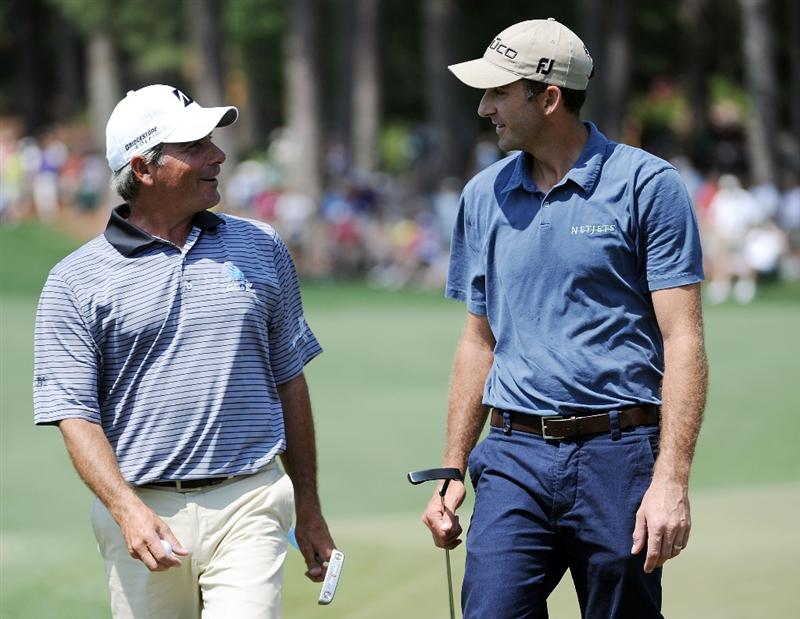 AUGUSTA, GA - APRIL 10:  Geoff Ogilvy of Australia (R) walks off the second green alongside Fred Couples  during the final round of the 2011 Masters Tournament at Augusta National Golf Club on April 10, 2011 in Augusta, Georgia.  (Photo by Harry How/Getty Images)