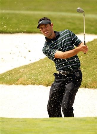 CASARES, SPAIN - MAY 19:  Charl Schwartzel of South Africa plays out of the second greenside bunker during the group stages of the Volvo World Match Play Championships at Finca Cortesin on May 19, 2011 in Casares, Spain.  (Photo by Warren Little/Getty Images)