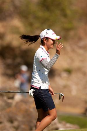 MORELIA, MEXICO - MAY 1: Ai Miyazato of Japan waves to the crowd after holing a putt from the fringe for birdie at the 16th hole during the third round of the Tres Marias Championship at the Tres Marias Country Club on May 1, 2010 in Morelia, Mexico. (Photo by Darren Carroll/Getty Images)