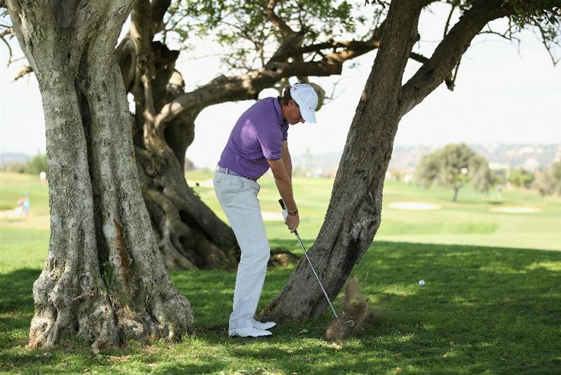 VILAMOURA, PORTUGAL - OCTOBER 16:  Maarten Lafeber of The Netherlands plays from behind a tree on the 3rd during the third round of the Portugal Masters at the Oceanico Victoria Golf Course on October 16, 2010 in Vilamoura, Portugal.  (Photo by Richard Heathcote/Getty Images)