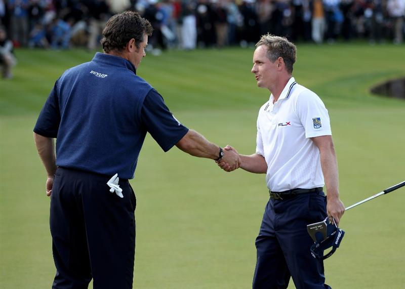 VIRGINIA WATER, ENGLAND - MAY 29:  Lee Westwood of England congratulates Luke Donald of England on victory in the playoff during the final round of the BMW PGA Championship  at the Wentworth Club on May 29, 2011 in Virginia Water, England.  (Photo by Richard Heathcote/Getty Images)