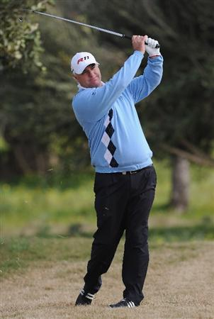 RAGUSA, ITALY - MARCH 18:  Stephen Dodd of Wales plays his approach shot on the 18th hole during the second round of the Sicilian Open at the Donnafugata golf resort and spa on March 18, 2011 in Ragusa, Italy.  (Photo by Stuart Franklin/Getty Images)