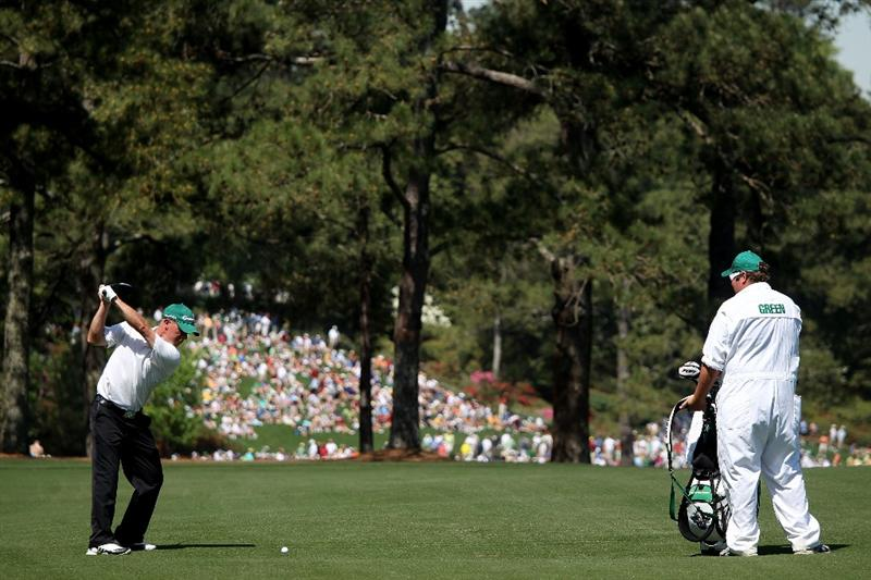 AUGUSTA, GA - APRIL 06:  Nathan Green of of Australia hits a shot from a fairway while his caddie looks on during a practice round prior to the 2010 Masters Tournament at Augusta National Golf Club on April 6, 2010 in Augusta, Georgia.  (Photo by Andrew Redington/Getty Images)