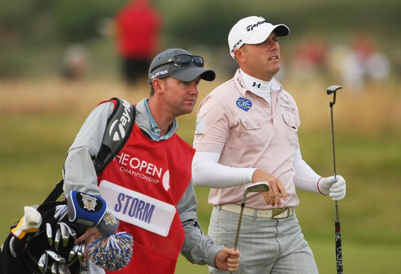 TURNBERRY, SCOTLAND - JULY 16:  Graeme Storm of England walks with caddy Darren Reynolds on the 2nd hole during round one of the 138th Open Championship on the Ailsa Course, Turnberry Golf Club on July 16, 2009 in Turnberry, Scotland.  (Photo by Andrew Redington/Getty Images)