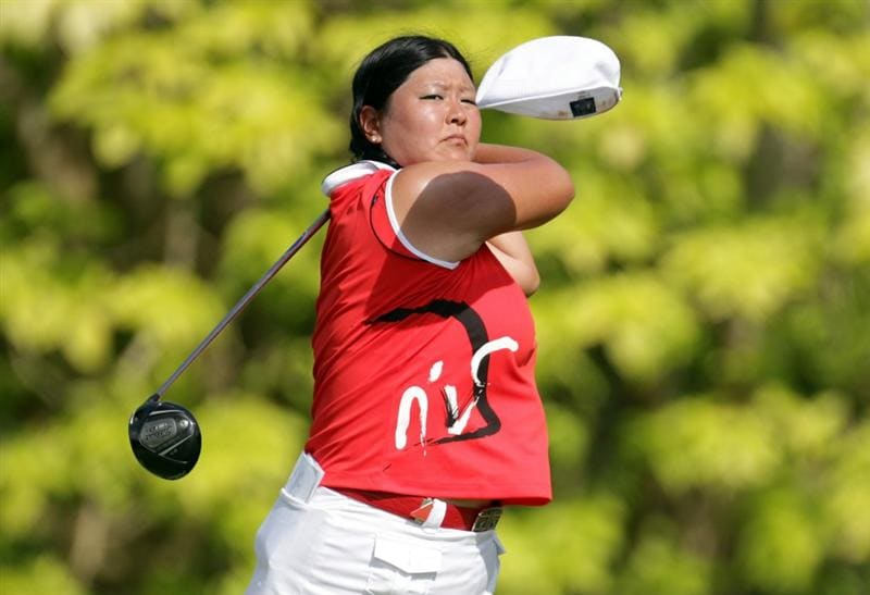 SINGAPORE - FEBRUARY 27:  Christina Kim of the USA loses her cap as she hits her tee shot on the sixth tee during the final round of the HSBC Women's Champions at Tanah Merah Country Club  on February 27, 2011 in Singapore, Singapore.  (Photo by Ross Kinnaird/Getty Images)