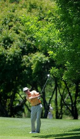 WEST DES MOINES IA. - MAY 29: Mark McNulty hits his approach shot to the 18th hole during the first round of The Principal Charity Classic held at the Glen Oaks Country Club on May 29, 2009 in West Des Moines, Iowa (Photo by Marc Feldman/Getty Images)