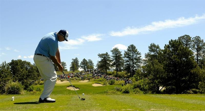 PARKER, CO. - MAY 30: Tom Lehman tees off the par three second  hole during the fourth and final round of the 71st Senior PGA Championship at the Colorado Golf Club on May 30, 2010 in Parker, Colorado.  (Photo by Marc Feldman/Getty Images)