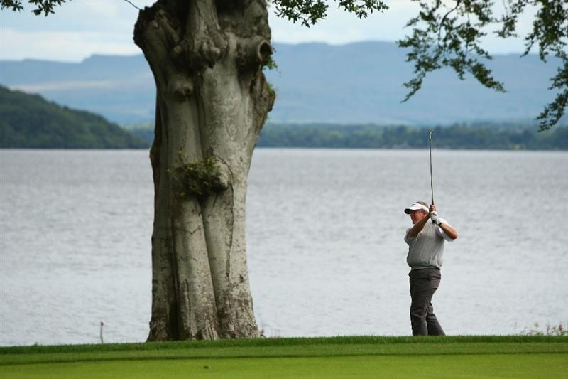 LUSS, SCOTLAND - JULY 09:  Colin Montgomerie of Scotland hits his second shot on the 7th hole during the First Round of The Barclays Scottish Open at Loch Lomond Golf Club on July 09, 2009 in Luss, Scotland.  (Photo by Richard Heathcote/Getty Images)