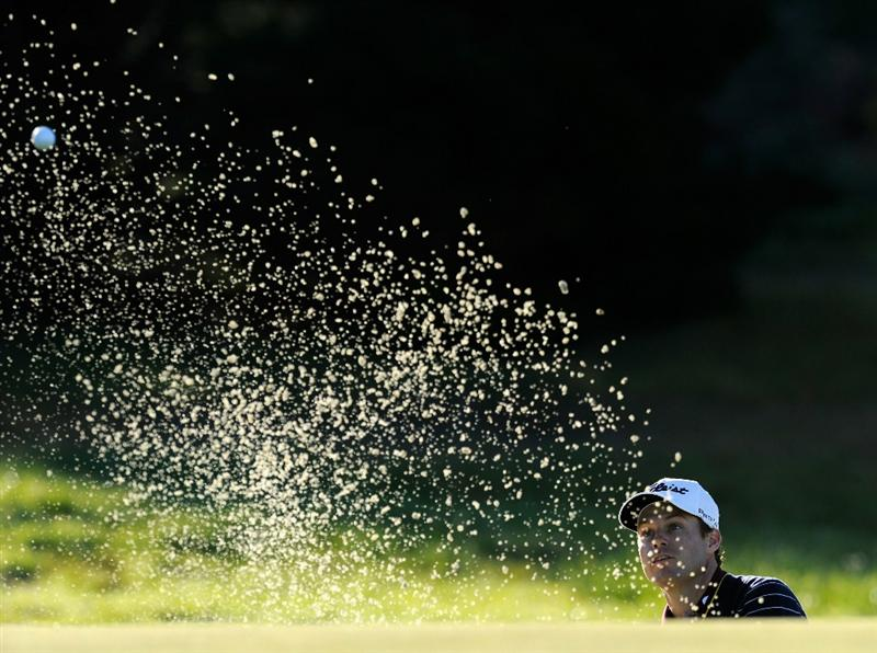 PEBBLE BEACH, CA - FEBRUARY 12:  Nick Watney plays his bunker shot on the first hole during the third round of the AT&T Pebble Beach National Pro-Am at the Spyglass Hil Golf Course on February 11, 2011  in Pebble Beach, California  (Photo by Stuart Franklin/Getty Images)