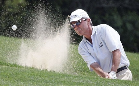 Mark McNulty of Orlando, Florida,  works out of trouble on the 18 green during the first playoff round of the 2005 Bank of America Championship at Nashawtuc Country Club in Concord, Massachusetts, Sunday, June 26, 2005.  McNulty won the match with a score of 12-under-par 204 after defeating Tom Purtzer during a two-hole playoff competitionPhoto by Jim Rogash/WireImage.com