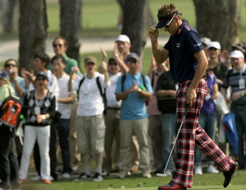 HONG KONG - NOVEMBER 19: Ian Poulter of England acknolweges the cheers from the crowd on sinking a birdie on the 9th hole during day two of the UBS Hong Kong Open at The Hong Kong Golf Club on November 19, 2010 in Hong Kong, Hong Kong.  (Photo by Stanley Chou/Getty Images)