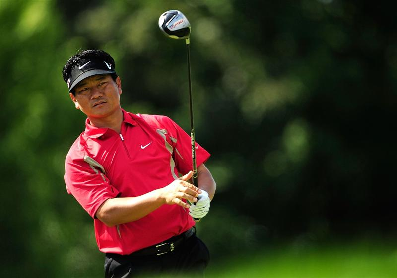 AKRON, OH - AUGUST 06:  K.J. Choi of South Korea plays a shot on the 6th hole during the first round of the WGC-Bridgestone Invitational on the South Course at Firestone Country Club on August 6, 2009 in Akron, Ohio.  (Photo by Sam Greenwood/Getty Images)