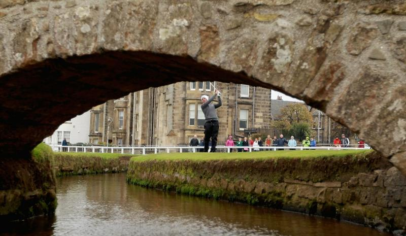 ST ANDREWS, SCOTLAND - OCTOBER 10:  John Parry of England plays his third shot to the first hole after driving into the burn during the final round of The Alfred Dunhill Links Championship at The Old Course on October 10, 2010 in St Andrews, Scotland.  (Photo by Warren Little/Getty Images).