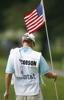 BETHESDA, MD - JULY 4: A caddie replaces the American flag flagstick into the 12th hole during the second round of the AT&T National at Congressional Country Club on July 4, 2008 in Bethesda, Maryland. (Photo by Hunter Martin/Getty Images)