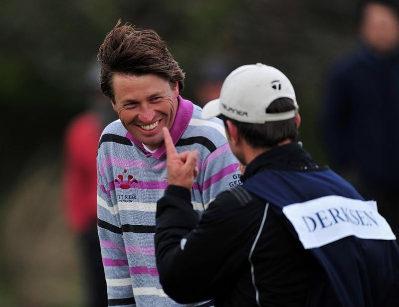 JEJU, SOUTH KOREA - APRIL 25:  Robert - Jan Derksen of The Netherlands shares a joke with his caddie on the 12th hole during the third round of the Ballantine's Championship at Pinx Golf Club on April 25, 2009 in Jeju, South Korea.  (Photo by Stuart Franklin/Getty Images)