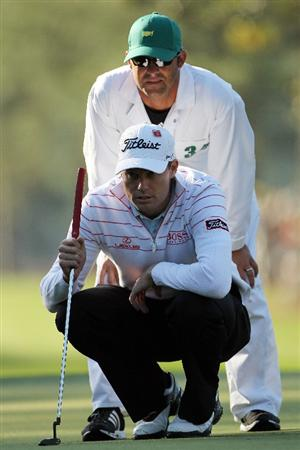 AUGUSTA, GA - APRIL 07:  Nick Watney lines up a putt on the first hole with the help of caddie Chad Reynolds during the first round of the 2011 Masters Tournament at Augusta National Golf Club on April 7, 2011 in Augusta, Georgia.  (Photo by Jamie Squire/Getty Images)