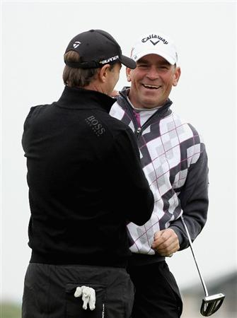 ST ANDREWS, SCOTLAND - OCTOBER 10:  Thomas Bjorn of Demark congratulates his amateur partner Nigel Taee onto the 17th green during the final round of The Alfred Dunhill Links Championship at The Old Course on October 10, 2010 in St Andrews, Scotland.  (Photo by Ross Kinnaird/Getty Images).
