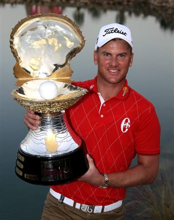 DOHA, QATAR - JANUARY 31:  Robert Karlsson of Sweden with the winners trophy after the final round of The Commercialbank Qatar Masters at The Doha Golf Club on January 31, 2010 in Doha, Qatar.  (Photo by Ross Kinnaird/Getty Images)