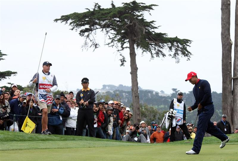 SAN FRANCISCO - OCTOBER 11: Tiger Woods of the USA Team birdies the 9th hole in his match against Y.E.Yang of South Korea and the International Team during the Day Four Singles Matches in The Presidents Cup at Harding Park Golf Course on October 10, 2009 in San Francisco, California  (Photo by David Cannon/Getty Images)