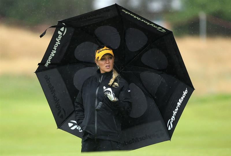 LYTHAM ST ANNES, ENGLAND - JULY 28:  Natalie Gulbis  of USA shelters under an umbrella during the Pro-Am prior to the 2009 Ricoh Women's British Open Championship held at Royal Lytham St Annes Golf Club, on July 28, 2009 in  Lytham St Annes, England.  (Photo by David Cannon/Getty Images)