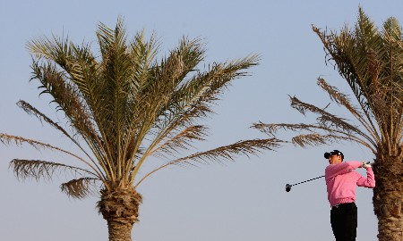 DOHA, QATAR - JANUARY 24:  Martin Kaymer of Germany hits his tee-shot on the 11th hole during the first round of the Commercialbank Qatar Masters at Doha Golf Club on January 24, 2008 in Doha, Qatar.  (Photo by Andrew Redington/Getty Images)
