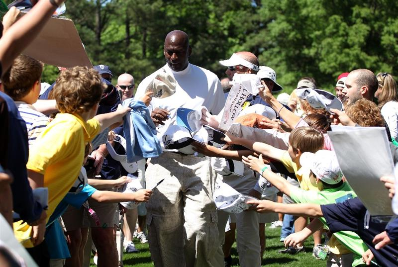CHARLOTTE, NC - APRIL 28:  Basketball legend Michael Jordan signs autographs for fans during the pro am prior to the start of the 2010 Quail Hollow Championship at the Quail Hollow Club on April 28, 2010 in Charlotte, North Carolina.  (Photo by Scott Halleran/Getty Images)