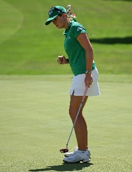 KAPOLEI, HI - FEBRUARY 21: Paula Creamer pumps her fist after making a birdie on the 9th hole to take the lead during the first round of the Fields Open on February 21, 2008 at the Ko Olina Golf Club in Kapolei, Hawaii. (Photo by Andy Lyons/Getty Images)