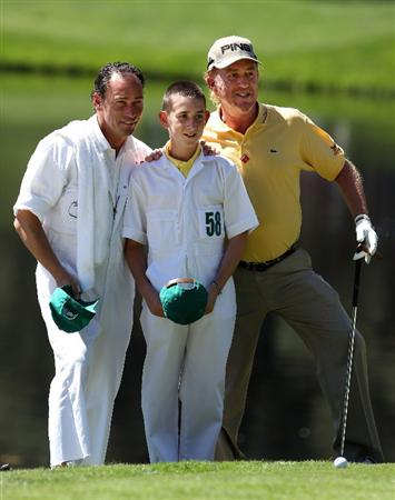 AUGUSTA, GA - APRIL 06:  Miguel Angel Jimenez (R) of Spain poses with his caddie Pepin Liria (L)and son Victor (C) during the Par 3 Contest prior to the 2011 Masters Tournament at Augusta National Golf Club on April 6, 2011 in Augusta, Georgia.  (Photo by Andrew Redington/Getty Images)