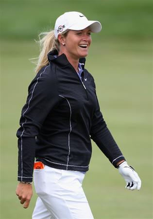 SPRINGFIELD, IL - JUNE 06:  Suzann Pettersen of Norway smiles after hitting her third shot on the third hole during the third round of the LPGA State Farm Classic golf tournament at Panther Creek Country Club on June 6, 2009 in Springfield, Illinois.  (Photo by Christian Petersen/Getty Images)