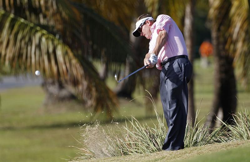 RIO GRANDE, PR - MARCH 10:  Shaun Micheel hits a shot from the rough during the first round of the Puerto Rico Open presented by seepuertorico.com at Trump International Golf Club on March 10, 2011 in Rio Grande, Puerto Rico.  (Photo by Michael Cohen/Getty Images)