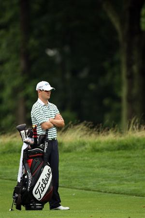FARMINGDALE, NY - JUNE 19:  Zach Johnson waits in a fairway during the continuation of the first round of the 109th U.S. Open on the Black Course at Bethpage State Park on June 19, 2009 in Farmingdale, New York.  (Photo by Ross Kinnaird/Getty Images)