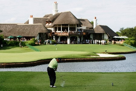 MALELANE, SOUTH AFRICA - DECEMBER 09:  Ernie Els of South Africa plays his fourth shot from the drop zone into the 18th green after eventually taking an eight on the 18th hole to loose the The Alfred Dunhill Championship at The Leopard Creek Country Club on December 9, 2007 in Malelane, South Africa.  (Photo by Warren Little/Getty Images)
