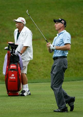 DUBLIN, OH - JUNE 03:  Jim Furyk and his caddie Mike Cowan watch a shot on the 11th hole during the first round of the Memorial Tournament presented by Morgan Stanley at Muirfield Village Golf Club on June 3, 2010 in Dublin, Ohio.  (Photo by Scott Halleran/Getty Images)