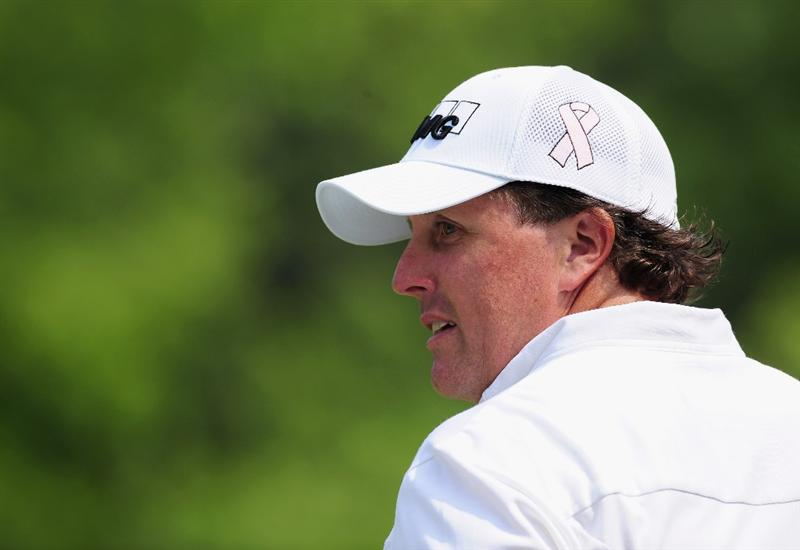 AKRON, OH - AUGUST 05:  Phil Mickelson of USA looks on during a practice round of the World Golf Championship Bridgestone Invitational on August 5, 2009 at Firestone Country Club in Akron, Ohio.  (Photo by Stuart Franklin/Getty Images)