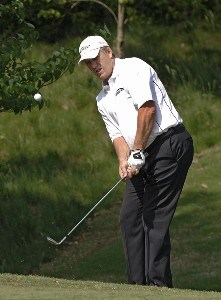 John Elway chips into the 15th green at the Cliffs at Keowee Vineyards during the first round of the Nationwide Tour BMW Charity Pro-Am, April 27, 2006 in Greenville, South Carolina.Photo by Al Messerschmidt/WireImage.com